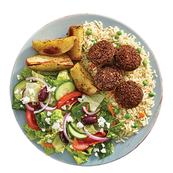 Falafel plate with crispy ground chickpeas, herbs and spices served with rice, potatoes, side Greek salad, dip